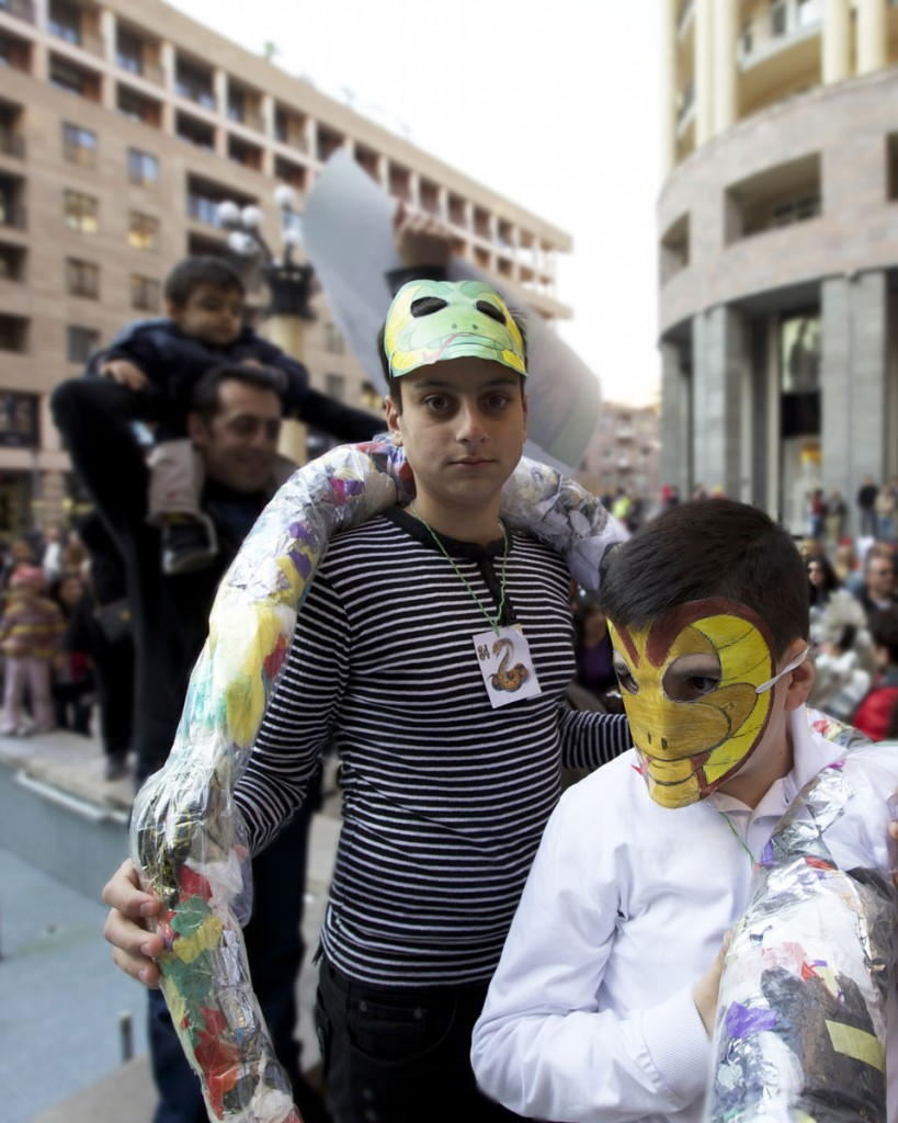 Armenian boy in costume asks for a photo, but offers no smile